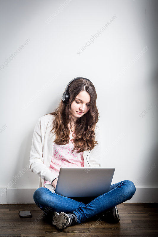 Teenager using a laptop