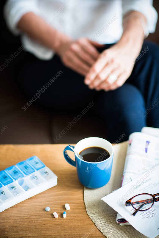 Medicine and coffee on a table
