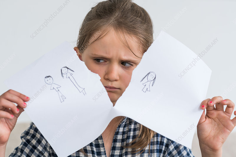 Child tearing apart drawing