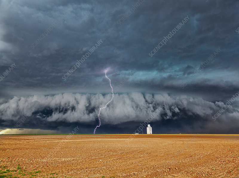 Lightning strike over wheat field, Kansas, USA