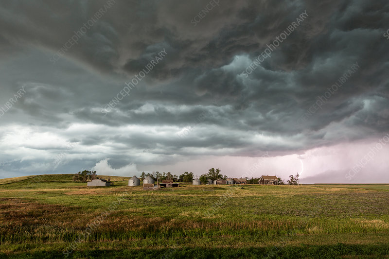 Storm over farmhouse, North Dakota, USA