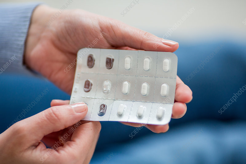 Woman taking medicines