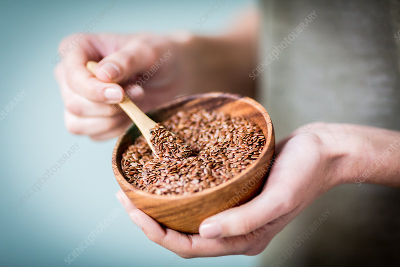 Woman eating golden flax seeds