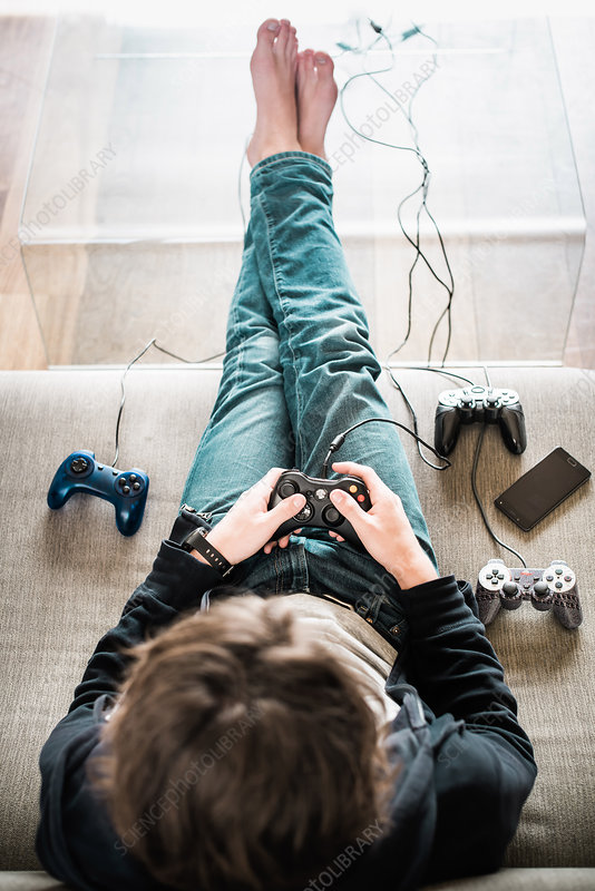 Teenager playing videogames