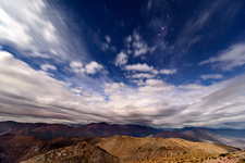 Clouds over Andean mountains, time-exposure image