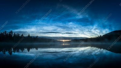Noctilucent clouds reflected in water