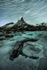 Star trails over Stetind mountain, time-exposure image