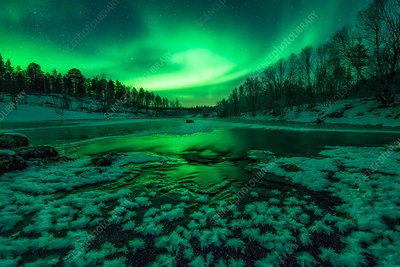 Aurora borealis over a river