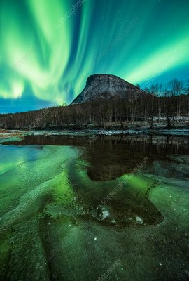 Aurora borealis over a mountain