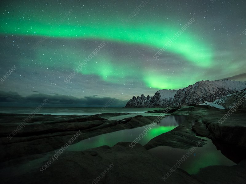 Aurora borealis over coastal mountains