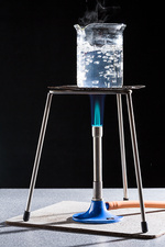 Boiling water with a Bunsen burner.