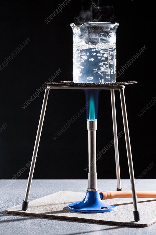 530_Boiling water with a Bunsen burner. - Stock Image C035/9330 - Science Photo Library