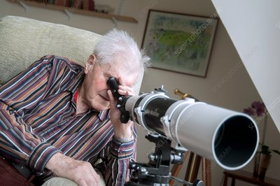 Care home resident with telescope