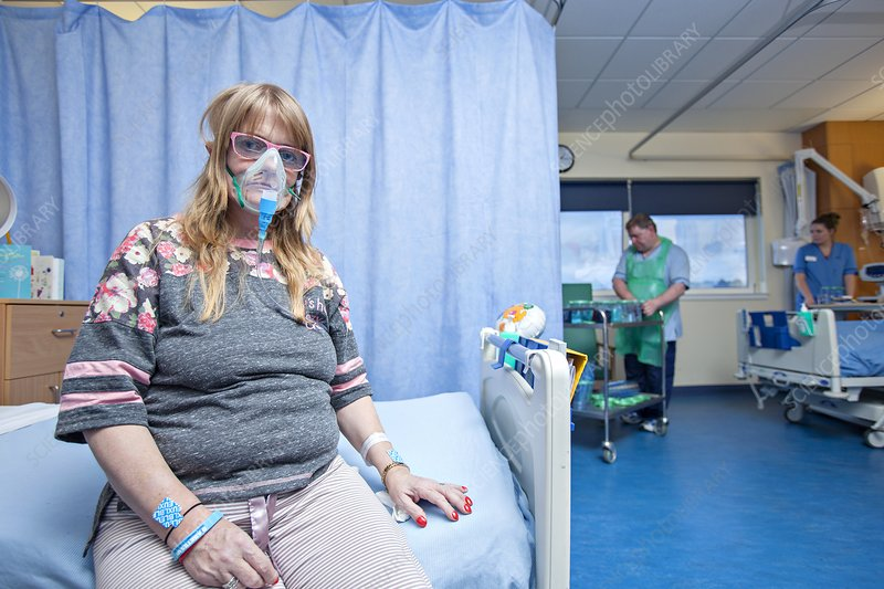 Hospital patient with an oxygen mask