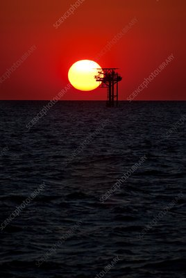 Oil platform at sunset, Gulf of Mexico