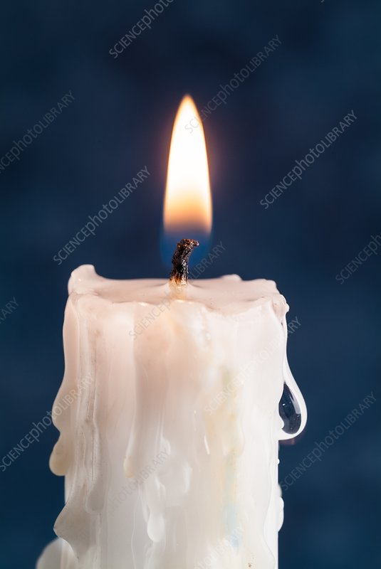 Lit candle with melted wax