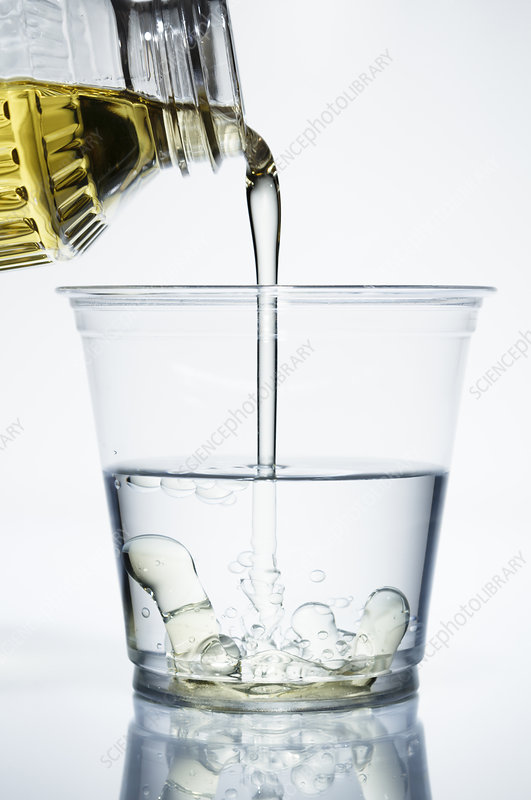 Pouring oil into water, 2 of 4