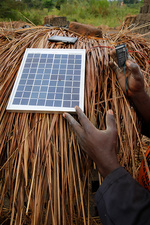 Brick factory worker using a solar panel