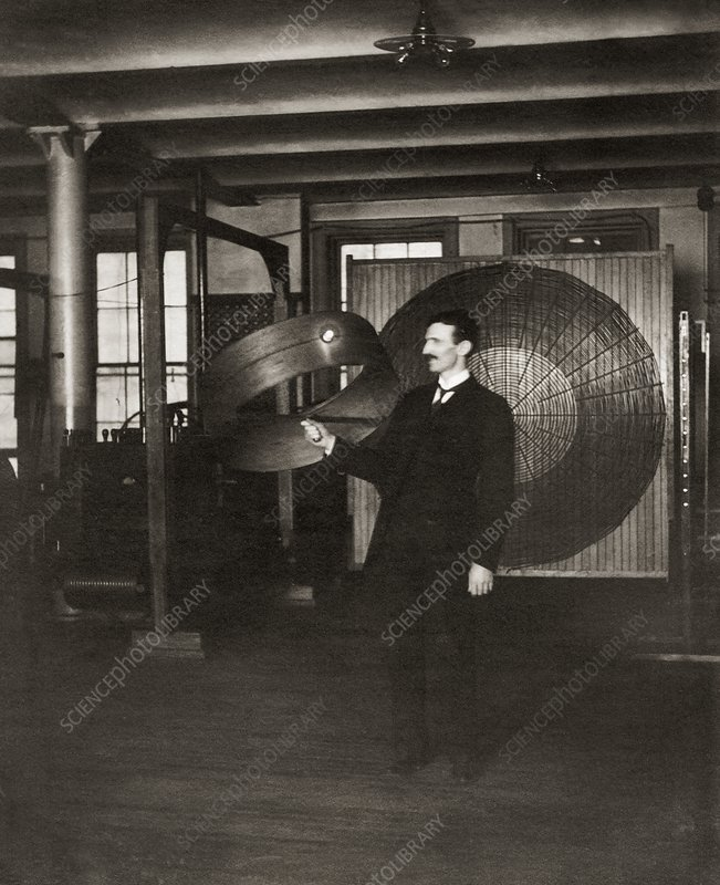 Tesla demonstrating his transformer
