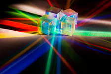 Light shining through RGB prisms from a projector
