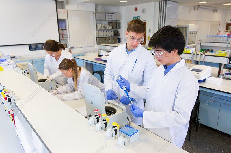 Chemistry students using centrifuges