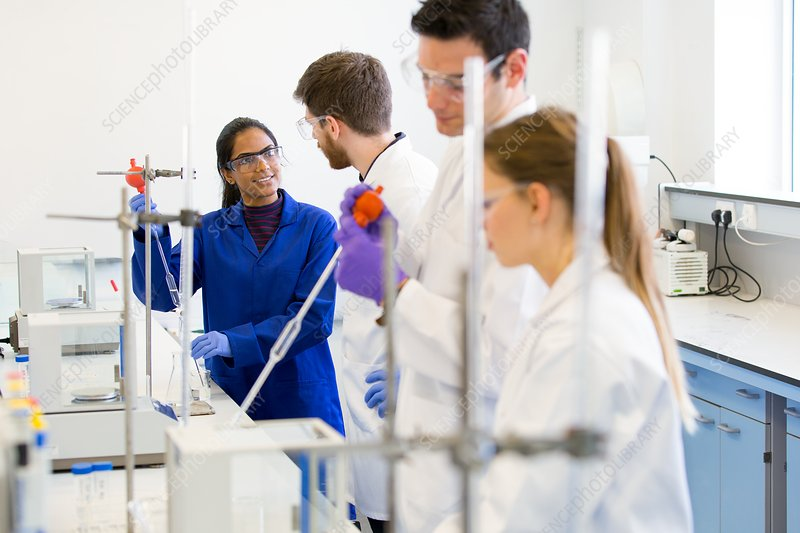 Chemistry students performing a titration experiment