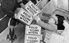 Polio vaccine being flown to Europe, 1955