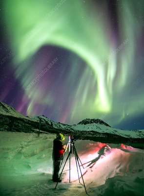 Photographer and the aurora in Alaska