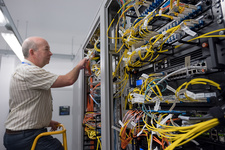 Technician checking server cables
