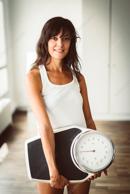 Woman holding on a scale