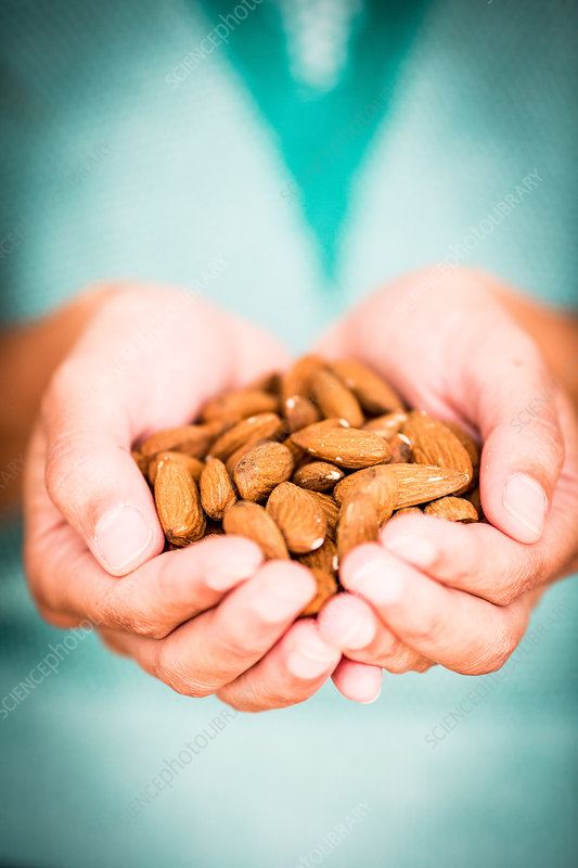 Woman holding almonds