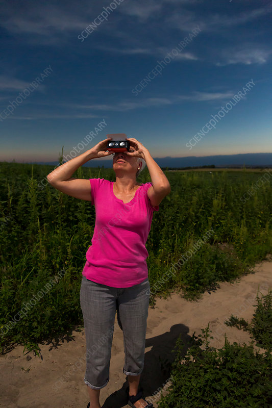 Woman watching total solar eclipse