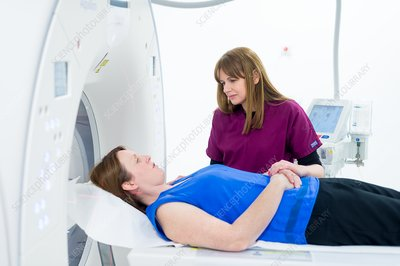 Radiographer preparing a CT scan