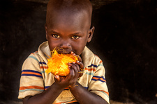 Young boy eating food