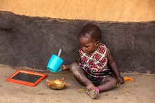 Young boy eating and drinking