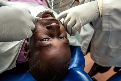 Hospital dentists treating a child