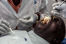 Hospital dentist treating a patient