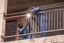 Construction workers welding railings