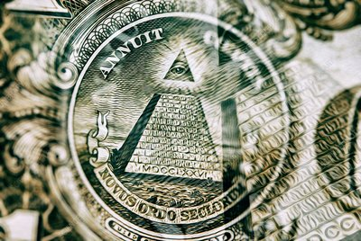 Pyramid and eye symbols on US dollar bill