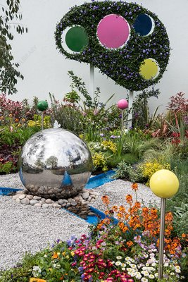 Contemporary show garden with spherical water feature