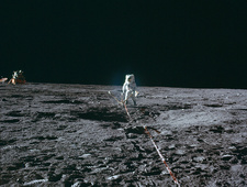 Apollo 12 astronaut setting up lunar experiment