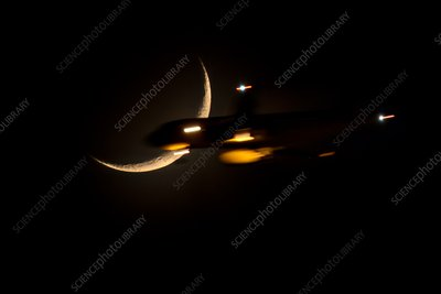 Crescent moon and plane