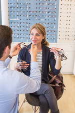 Woman trying prescription glasses