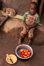 Young boy preparing food