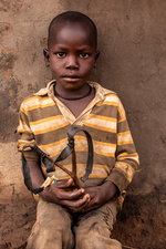 Young boy with a catapult