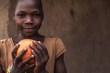 Boy holding fruit