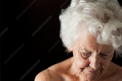 Tired elderly woman