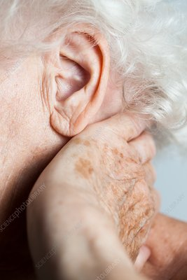 Elderly woman with neck pain