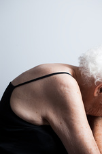 Elderly woman with bent posture