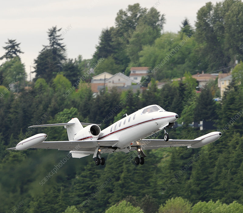 Learjet taking off